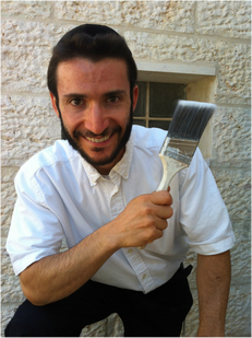 Nachum Shore, painting contractor holding Purdy paintbrush